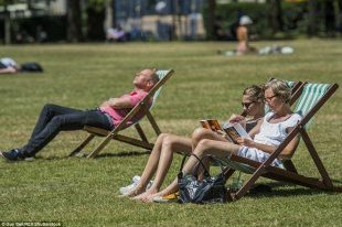 Here comes the sun (again): After Thursday's storms, the sun came out once again today prompting people to flock to Green Park, London