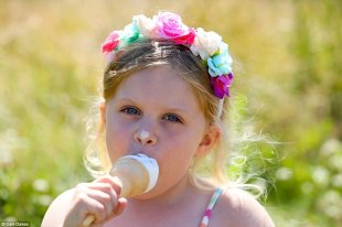 Missed a bit! Summer Bayes, four, enjoys an ice cream in the sunshine at Marine Park in South Shields as the UK basks in warm weather