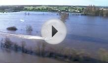 Water-skier deftly navigates flooded village in north England